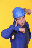 Tradesman holding a mallet on his shoulders