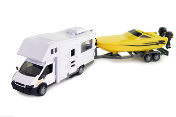 Camping vehicle pulling speed boat on trailer