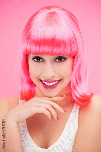 Smiling woman over pink background
