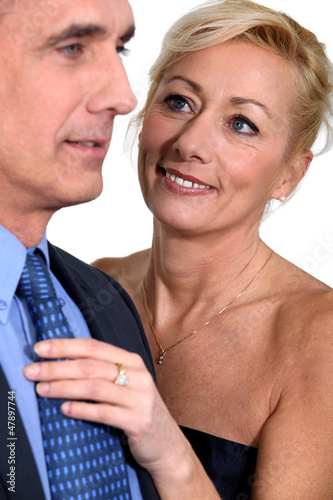 Mature couple in evening dress