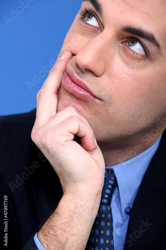 Close-up shot of a pensive businessman