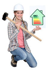 Woman with energy rating poster