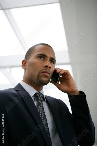 African businessman calling his boss