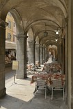tables set for eating under arcades, Busseto