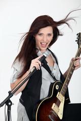 Girl playing guitar and singing
