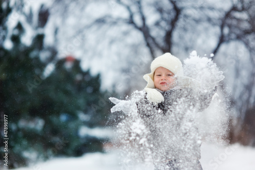 snowy winter outdoors boy playing with snow