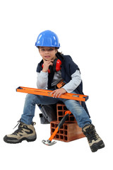 Child dressed as a builder
