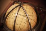 Vintage travel star sky globe in wooden box poster