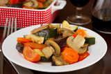 boiled vegetables with mushrooms on the plate with fork
