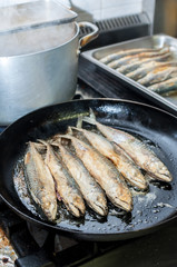 Fillet of mackerel fried in restaurant kitchen