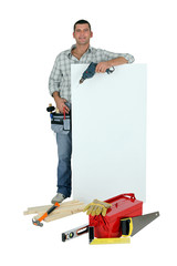 Handyman with tools and message board