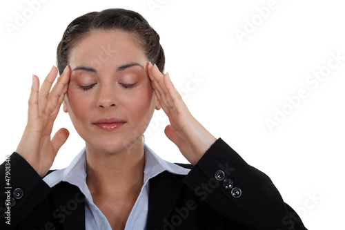 Businesswoman with tension headache