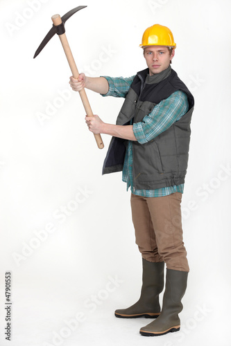 Man holding pick axe