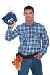 Man with an electric jigsaw