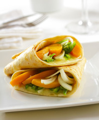 Delicious vegetable tortilla wrap with melted mozarella cheese