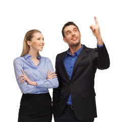 man and woman pointing their fingers