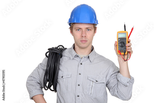 Electrician showing multimeter