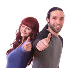 Mann und Frau zeigen Daumen hoch