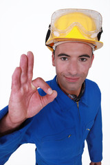 closeup portrait of craftsman making ok sign