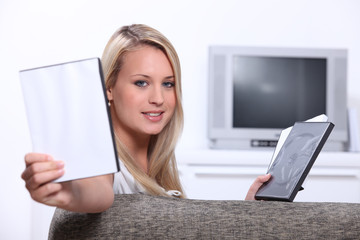 Young woman choosing a DVD with a case for message