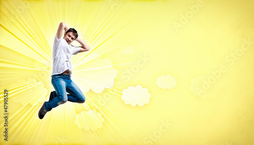 young man dancing and jumping...
