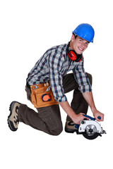 Workman with a circular saw