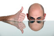Bald man giving thumbs-up