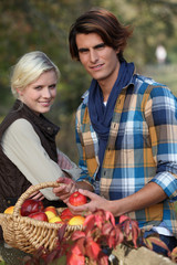 Young couple picking apples