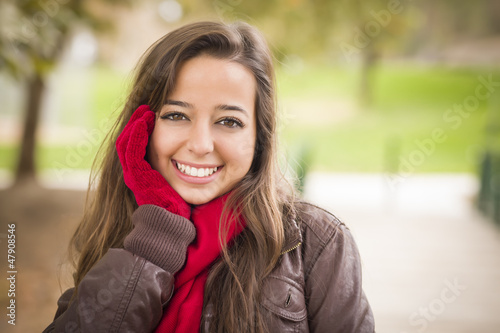Pretty Woman Portrait Wearing Red Scarf and Mittens Outside