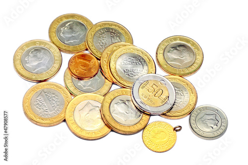 Heap of various coins and a gold. Isolated on white background