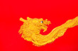Golden dragon on red wall