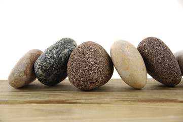 Several different stones isolated over wood board