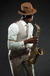 Black american jazz saxophone player. Vintage. Studio shot.