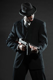 Black american mafia gangster man in suit with gun.