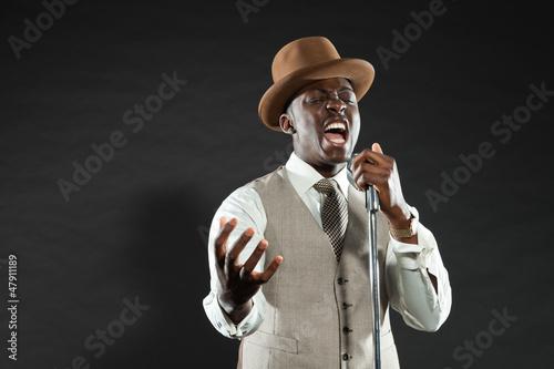 Black american jazz singer. Vintage. Studio shot.