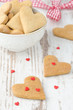 heart shaped cookies on the table and sugar hearts