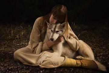Slavonian girl and siberian husky in the deep forest