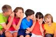 Happy children whispering