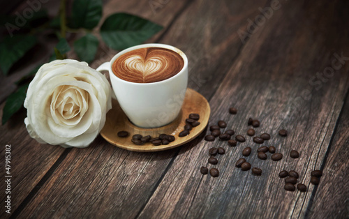 Hot coffee and beautiful white rose