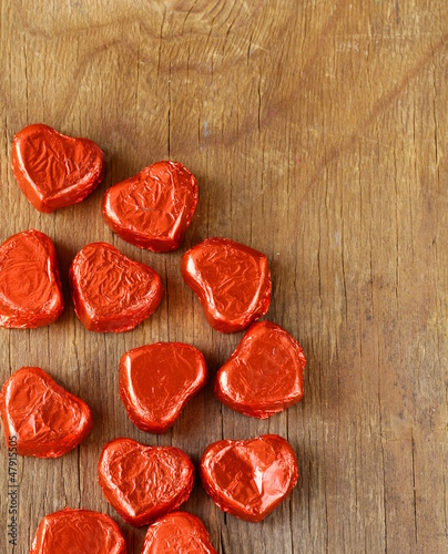 chocolates in  heart shape on a wooden background