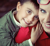 Cute boy smiling with his mom