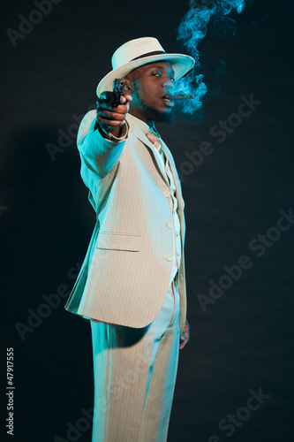 Black american mafia gangster man in suit with pistol.
