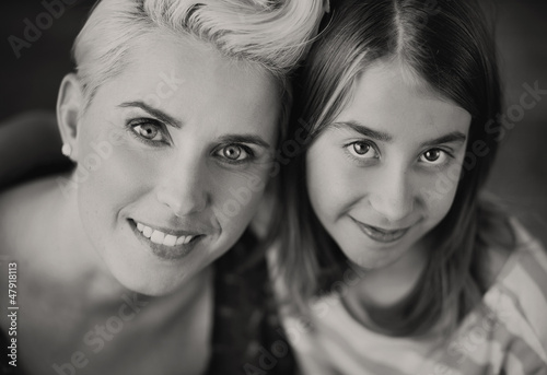 Blonde mother enjoying daughter's company