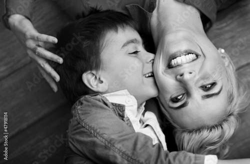 Pretty shoot of cute boy kissing mother