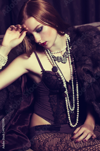 Provocative Sophisticated Redhead Woman in Black Lingerie, Beads