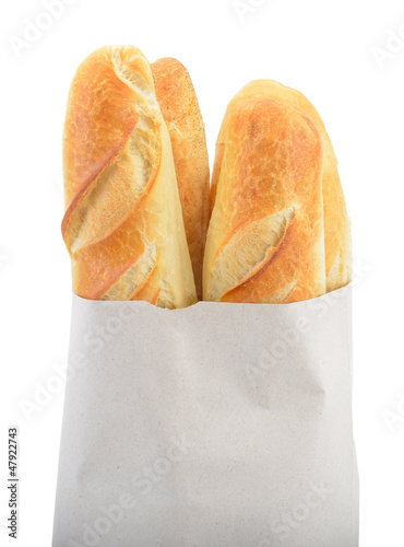 Baguette bread in paper bag isolated on white