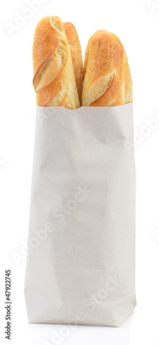 Baguette in paper bag isolated on white background