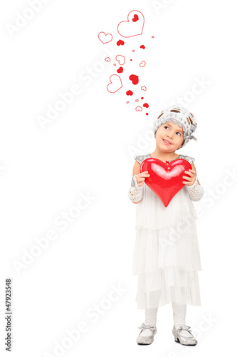 Full length portrait of a girl holding a red heart and looking a