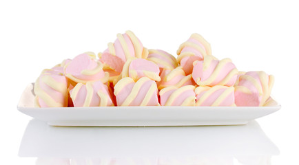 Marshmallows on plate isolated on white
