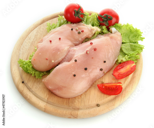 raw chicken meat on cutting board, isolated on white